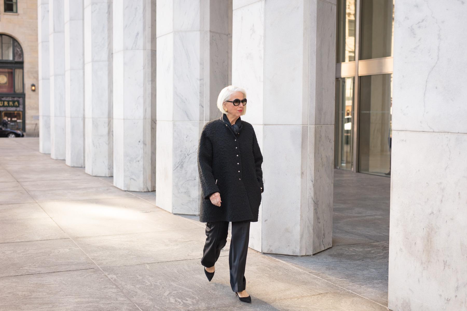 Modern, editorial portraits for NYC law firm stylish elderly lawyer walking on 5th Ave BG