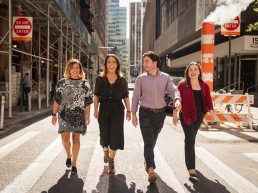 Fun team portraits of NYC creative marketing agency walking on streets of lower Manhattan