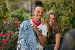 Lifestyle photography of cute young couple laughing and talking at NYC park