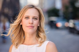 Business headshots of Hayley Evans, founder of consulting firm CreatevsReact, in scenic Dumbo, Brooklyn