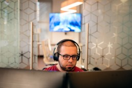 Office Lifestyle - Business & Corporate Lifestyle Photography NYC Tech Engineer Wearing Headphones
