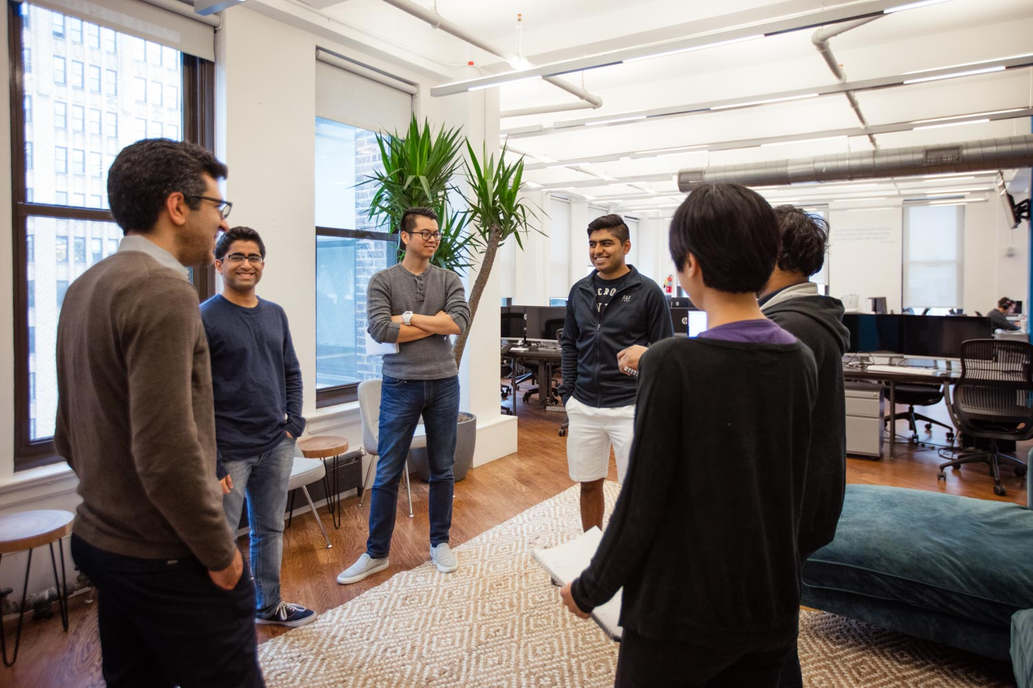 Office Lifestyle - Business & Corporate Lifestyle Photography NYC Tech Team Huddle Meeting
