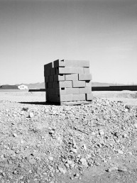 Black and white fine art landscape of stacked bricks at abandoned construction site 2009 foreclusure crisis Las Vegas