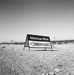 Black and white fine art landscape photography of American West sign in Las Vegas desert during 2009 foreclusure crisis