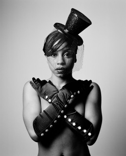 Black and white fine art nude portrait of black model in top hat and silk gloves New York City