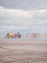 Fine art landscape photography of an ocean-side flooded playground after Hurricane Sandy hit Queens, New York