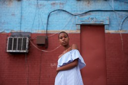 Brooklyn Fashion Photographer | Black Model with Shaved Head in Blue Striped Dress