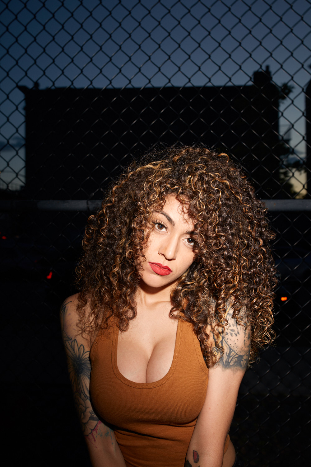 Fashion Photographer New York City | Tattooed Latina Model in Tank Top in Brooklyn Park at Night