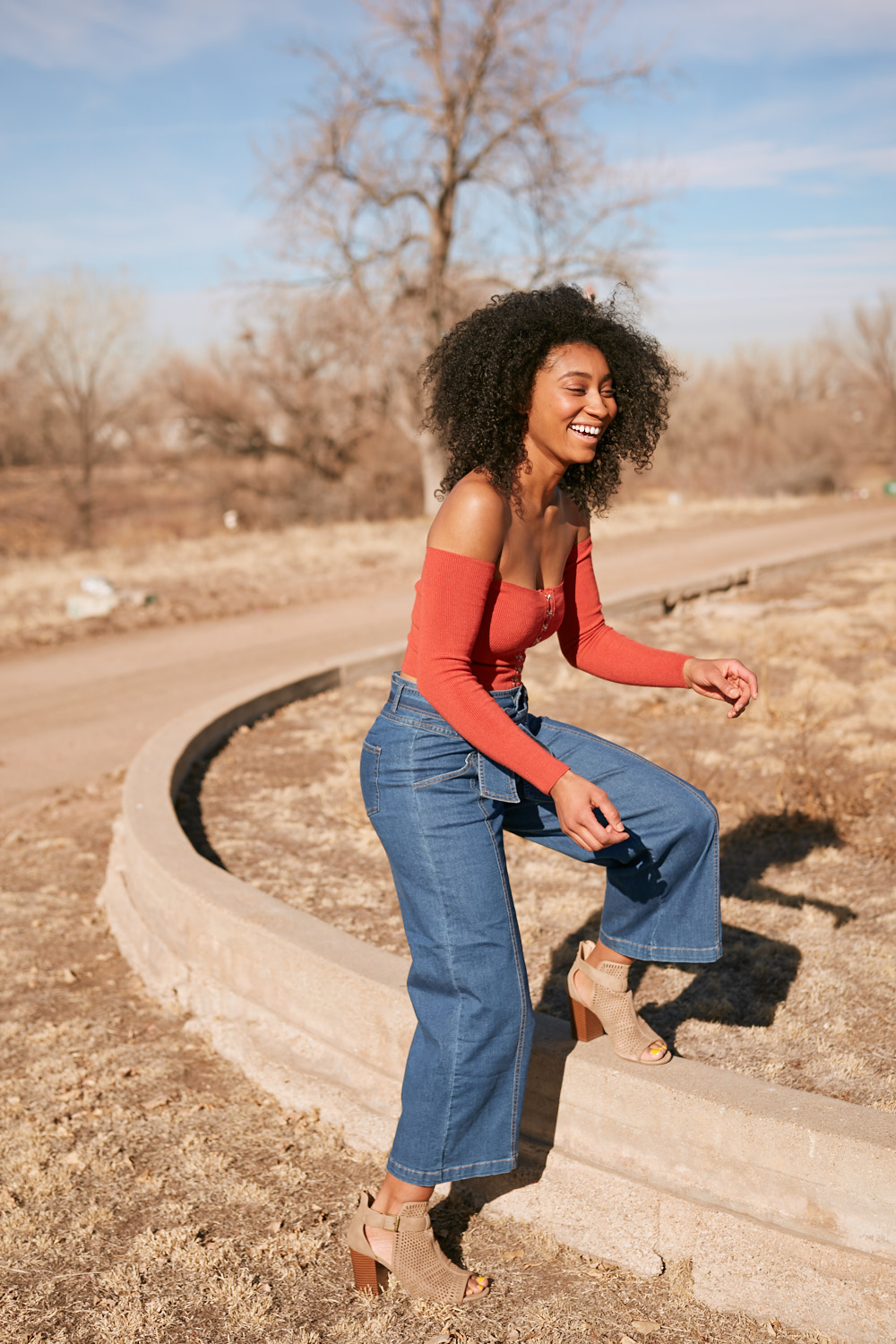 NYC Fashion Photographer | Black Model Laughing in Denver FIeld