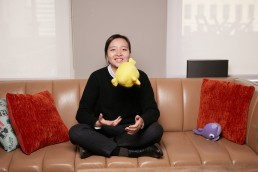 Casual Business Portraits of Tilting Point Marketing Manager tossing a plush toy NYC Header