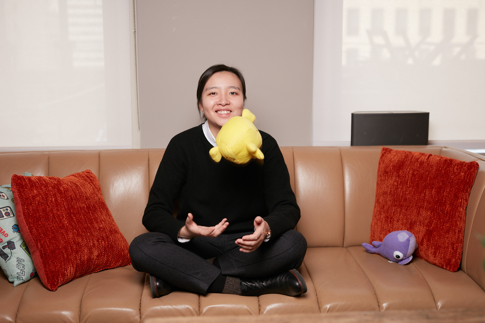 Dallas Portrait Photographer | Casual Business Portraits of Tilting Point Marketing Manager tossing a plush toy