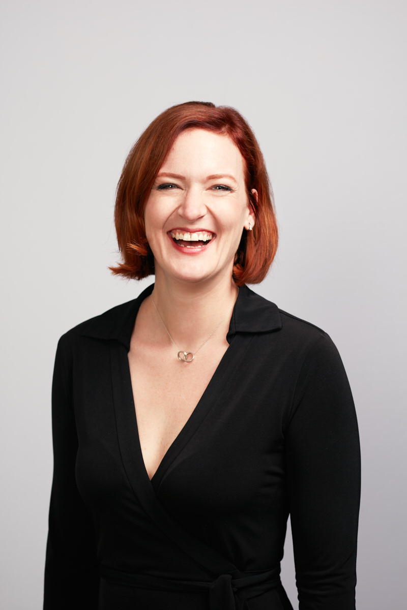 Creative, Editorial-Style Headshots of Smiling Red-Head Woman for Healthline Dallas