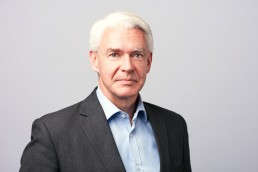 Modern Executive Headshots of White-Haired Businessman Midtown NYC