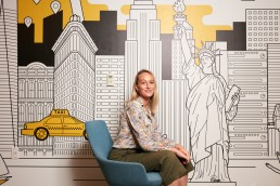 Creative business portraits of young female executive with NYC mural