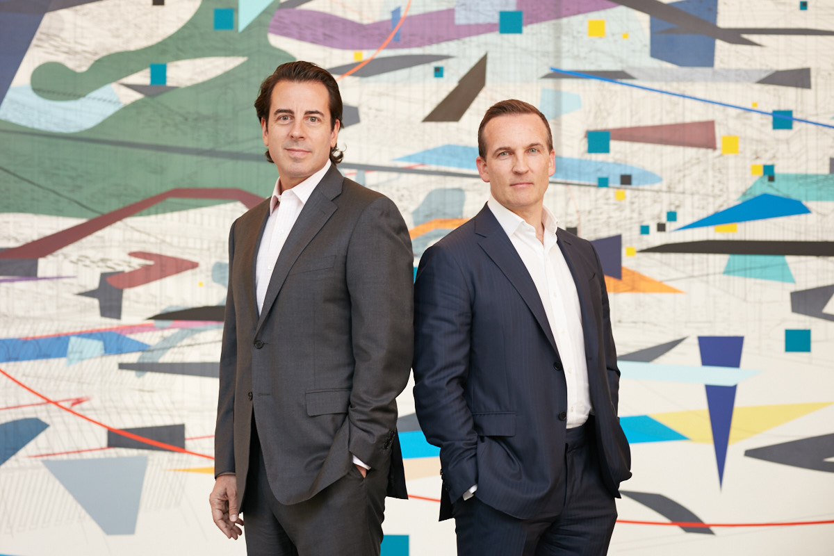 Executive portraits of Goldman Sachs partners by painting artwork in downtown Dallas