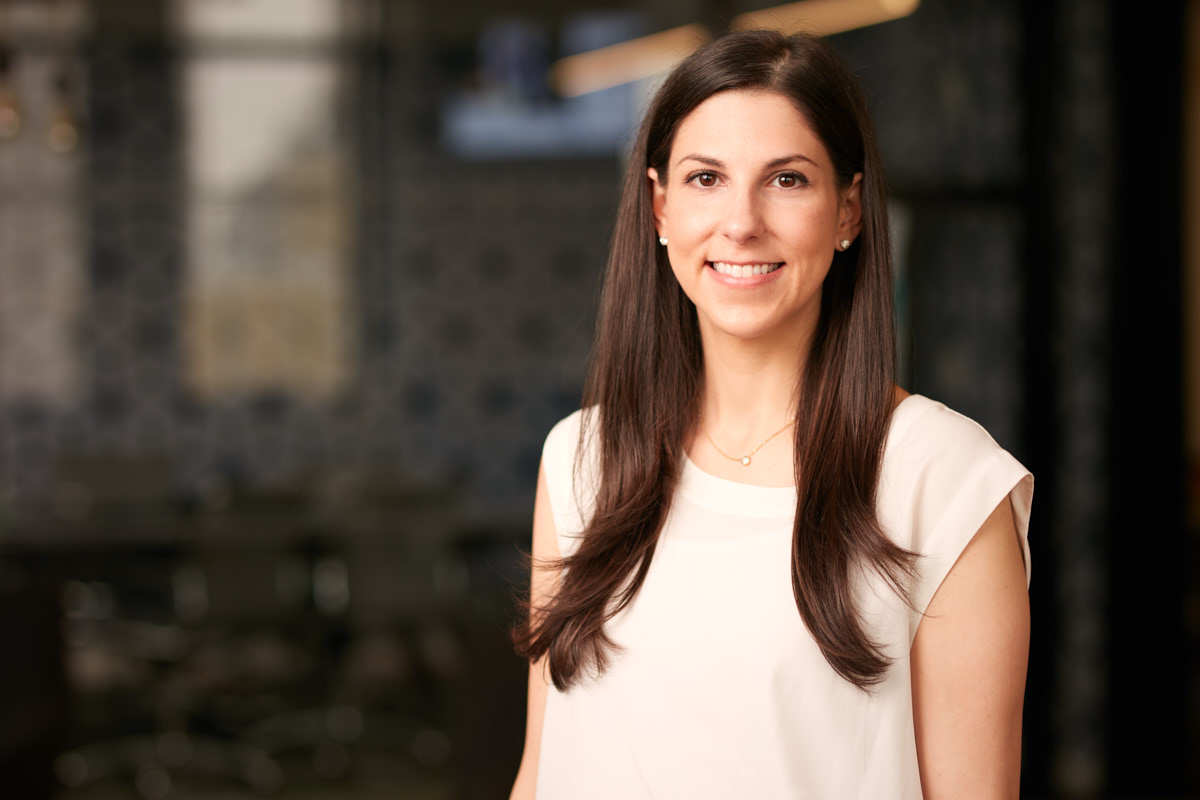 Modern corporate headshots of young female executive NYC