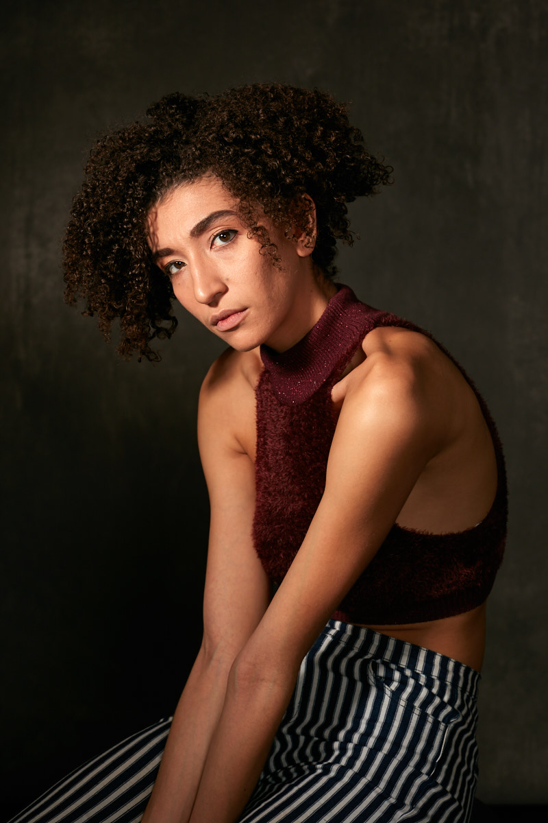 Modern fashion portrait photography of young mixed race model in Dallas studio