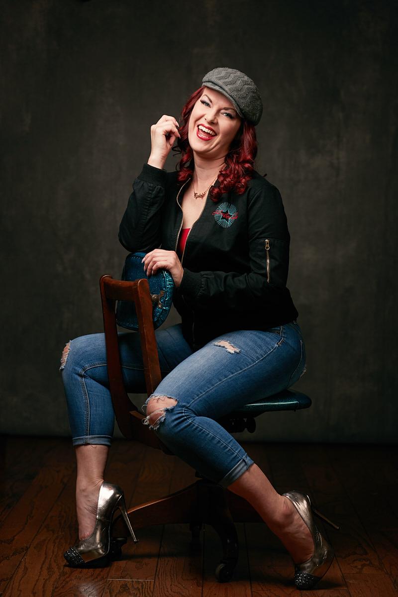 Dallas Portrait Photographer - Casual portrait of stylish woman laughing on designer chair