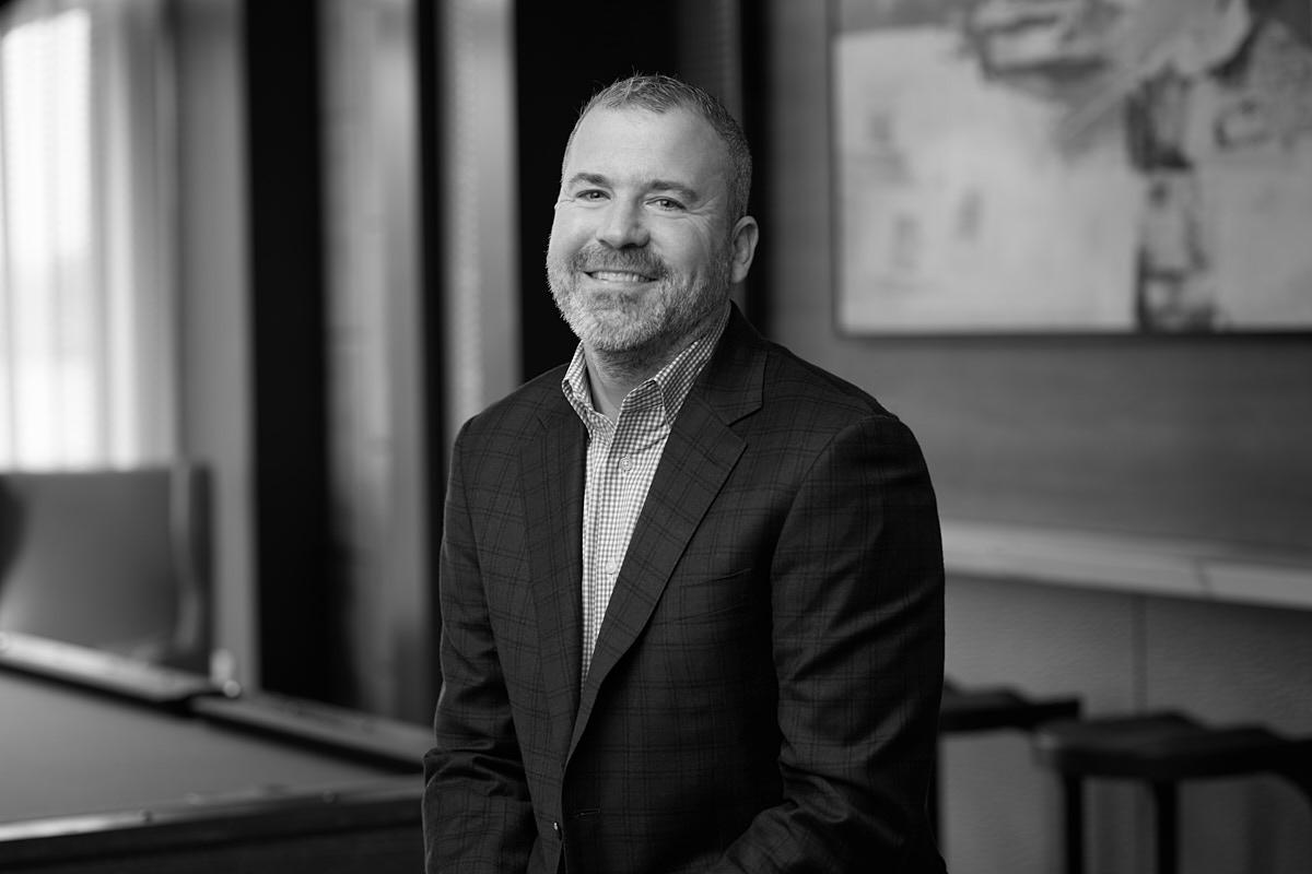 Classic black and white corporate headshots of major real estate developer