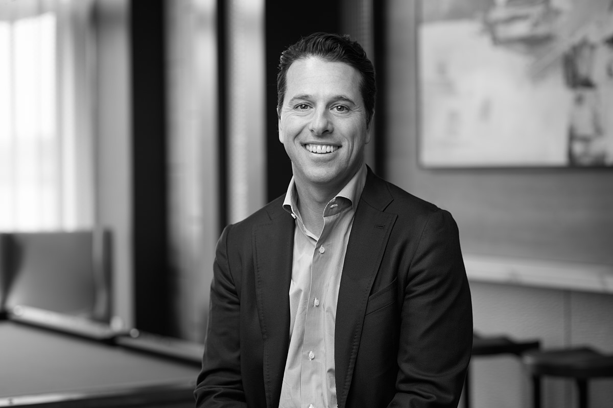 Classic black and white headshots of CEO of real estate development company