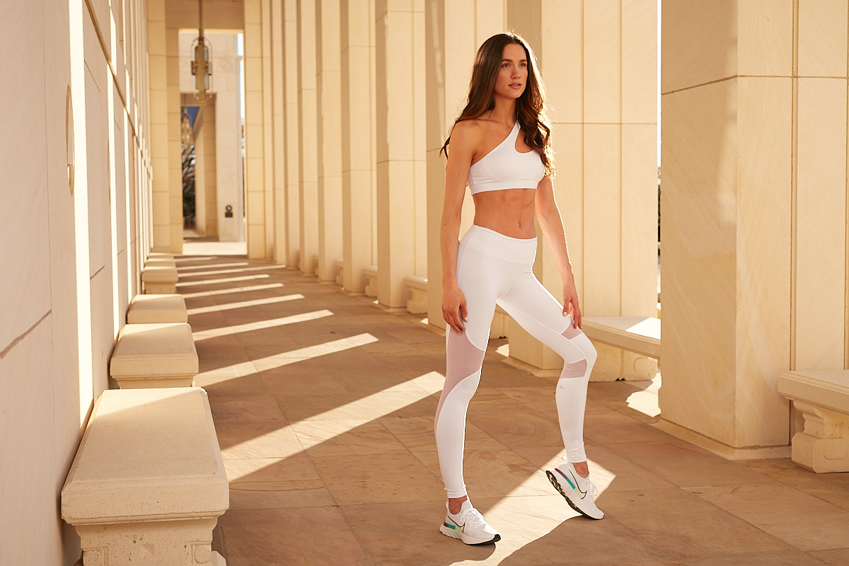 Fitness Photographer Dallas | Tall Brunette Woman in Running Outfit at Hall of State