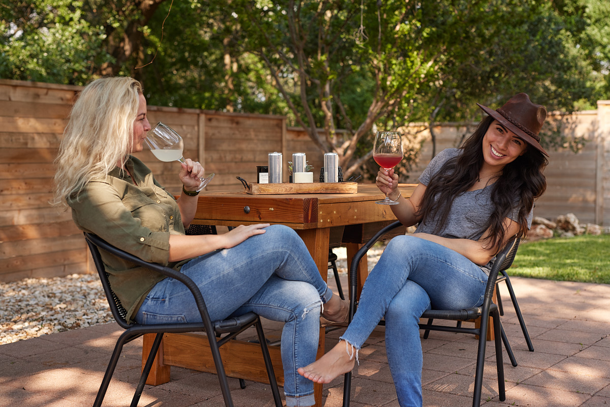Austin Branding Photography of Young Female Entrepreneur Having Drink with Friend Texas