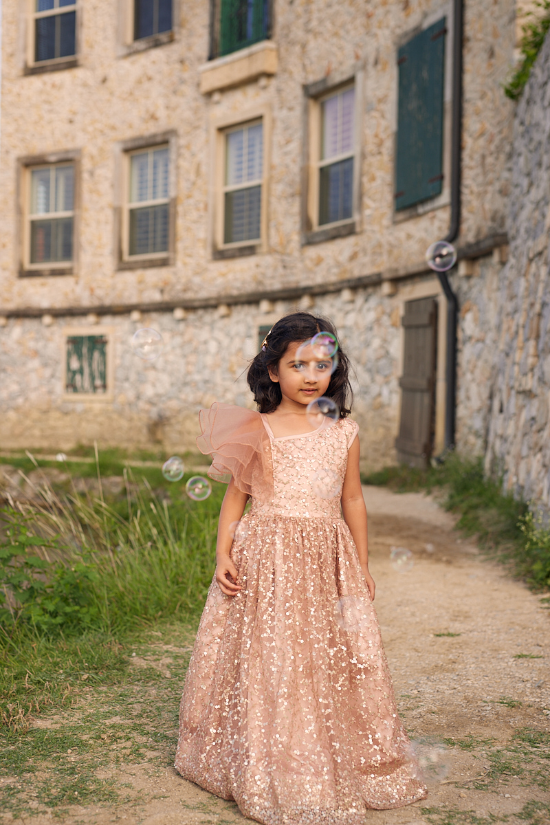 Kids fashion photography of girl in shiny dress and bubbles at Adriatica Village McKinney, Texas