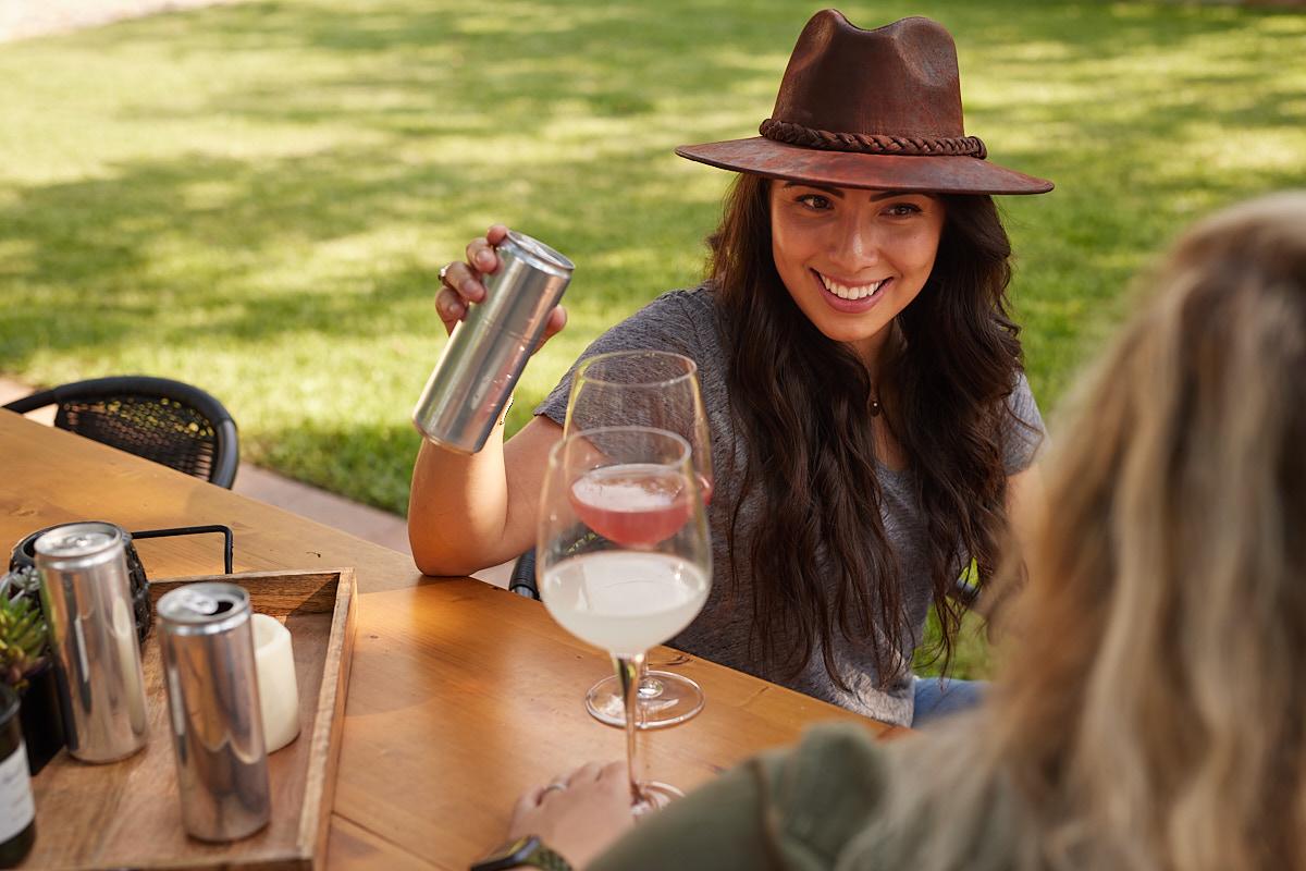 Dallas Branding Photography of Young Female Entrepreneur Pouring Soda Drink Austin Texas