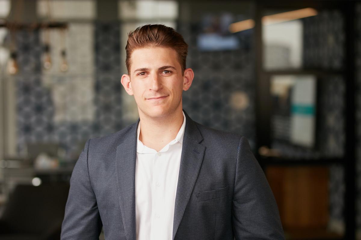Environmental Office Headshots of Young Executive   Dallas Headshot Photographer
